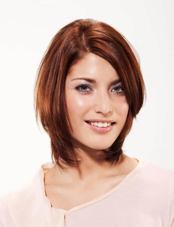 Layered bob hair cut with medium auburn hair color