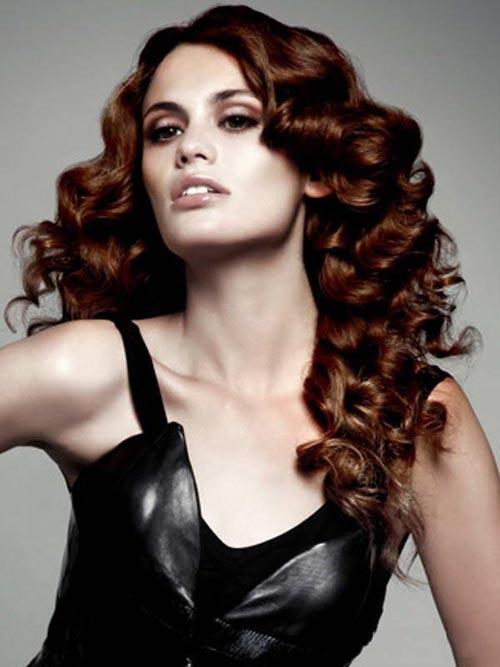 Brown red curly hairstyle with copper strands