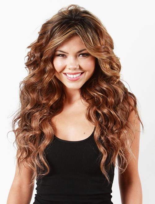Long curyly hairstyle with chestnut hair color with caramel highlights
