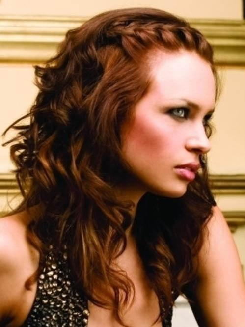 Long half braided hairstyle with a brown red hair color