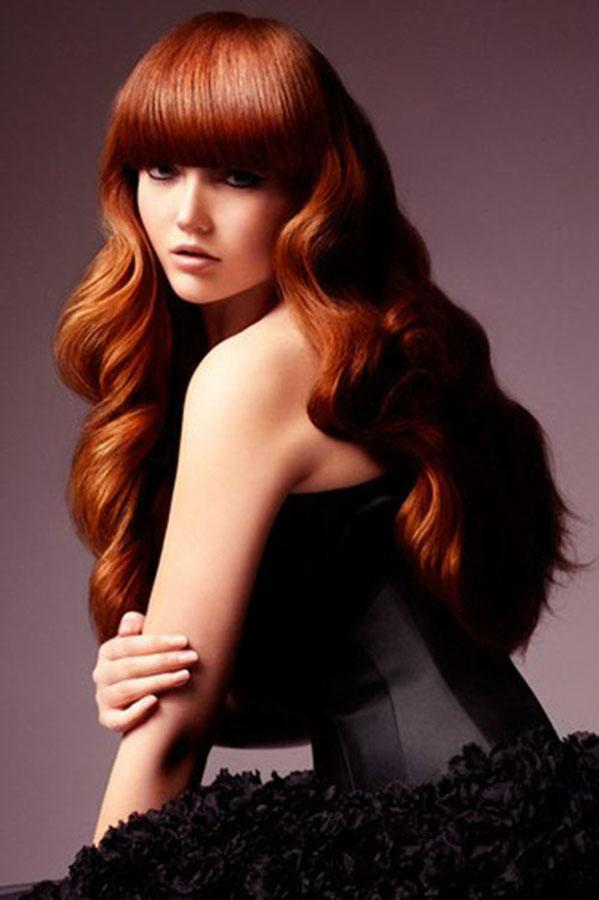 Long light chestnut hairstyle with bangs
