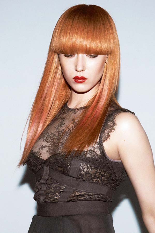 Straight ginger hairstyle with thick bangs