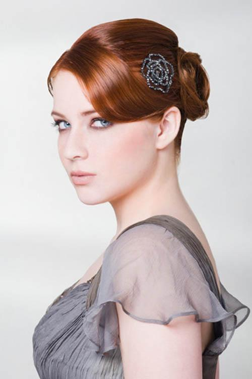 Red hairstyle with chignon and hair accessory