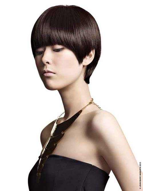 Short straight dark brown haircut Asian woman